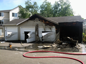 Snohomish County Fire District 7 firefighters quickly handled a garage fire south of Mill Creek on Thursday afternoon, June 6, 2013. One person was taken to hospital with burns to his legs and face.