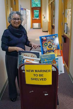 Sno-Isle Libraries Executive Director Jonalyn Woolf-Ivory with books that are destined for shelves at the new Mariner Library. Photo courtesy of Sno-Isle Libraries.