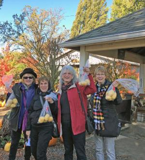 After tasting oven-baked fries samples, Pat, Julie, Marla and Judy purchased the special golden potatoes used by Gordon's. Photo courtesy of Mill Creek Garden Club.