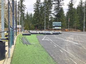 The old artificial turf and chain link fencing has been removed from the Mill Creek Sports Field in preparation for their replacement. The construction contractor is making an effort to stay on schedule and hopes to reopen the field as by late April, despite recent weather challenges.
