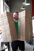 "MOD Pizza will be making a $3,453.59 donation to the Mill Creek Food Bank representing a percentage of their sales the first day. Rob Briggs was the winner of the ""Pizza for a Year"" grand opening drawing on May 1st."
