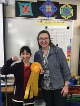 Forest View Elementary School student Callia Park's tilted dispenser invention earned state recognition at the Washington State Innovation Convention on March 23, 2019. She will go on to compete nationally in May.