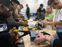 Cascade High School students build sheet-metal boxes. Photo courtesy of Everett Public Schools.