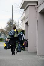 Community Transit employees delivering backpacks for homeless students at Everett High School. Photo courtesy of Community Transit.