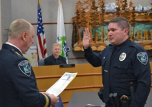Earl Cowan, Mill Creek's newest police officer, took his oath of office at the beginning of the April 8, 2014, city council meeting.