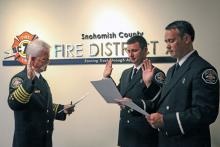 Lieutenants Karapostoles and Hammeren taking oath from Chief Gary Meek. Photo courtesy of Fire District 7.