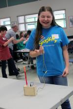 "Students worked with their parents using kits from Microsoft's HACKING STEM program to build sensors to control a ""mechanical finger."" Photo courtesy of Heatherwood PTA."