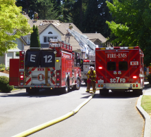 Multiple firefighting crews from both Fire District 7 and Fire District 1 responded to a house fire just off of Village Green Drive in the Fairwood Greens housing division of Mill Creek on Saturday afternoon, July 4, 2015.