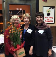 Carol Anne, Pat and Susan check out a beautiful Crocosmia. A perfect choice for a gardener. Photo courtesy of Mill Creek Garden Club.