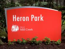 This is the new sign at Heron Park, by the entrance to the Parkside development off Village Green Drive in Mill Creek. The sign is made out of solid aluminum and, love it or hate it, the sign is permanent.