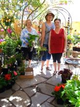 Open house at Lynn's Gift and Garden in Bothell. From left to right: Sandy Somers (MCWC), Nancy Knox (MCWC), Stacy (Lynn's Gift and Garden). Photo credit: Patricia Huckell.