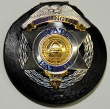 Washington State Troopers have been authorized to wear a specially designed badge to commemorate the historic graduation of the 100th Trooper Basic Training Class.