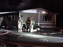 Residents were displaced after firefighters quickly contained a North Creek mobile home fire on Wednesday evening, January 16, 2019. One firefighter was treated at the scene for minor injuries.